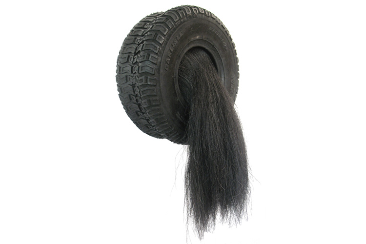 "<b>Untitled (Small Tire), 2009</b><br>24""H x 12.5""W x 10""D<br<rubber tire, horse hair, fabric"