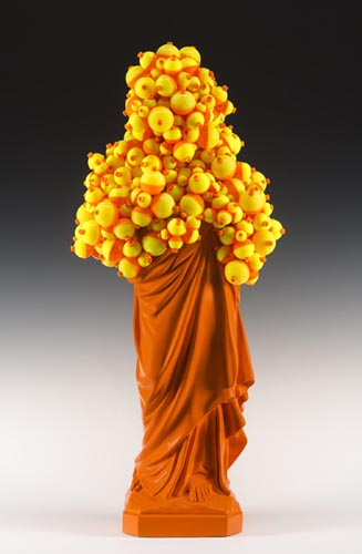 "<b>Float (orange), 2012</b><br>34"" x 15"" x 10""<br>re-purposed resin figure, plastic floats, paint, plaster and steel"